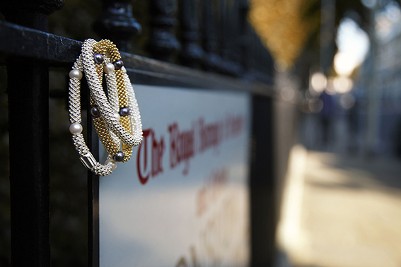 image: LINKS bracelet on sign